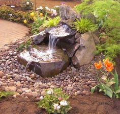 DRY CREEK BEDS WITH A WATER FEATURE | add a water feature to your yard boulder creek waterfall or fountain ...