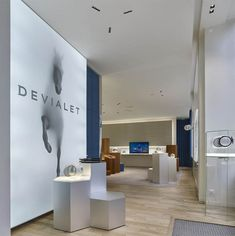 Devialet is a destination to experience its cutting-edge technologies.A calm place where the experience comes from the acoustic excellence High Contrast, Downlights, Creative Design, Showroom, Blade, Boutique, Furniture, Paris City, City Style