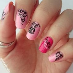 A wonderful looking pink nail art design, Baby pink and salmon pink colors are used as base with black colored details on top forming a rose. White polish is also used for additional details.