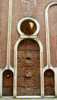 Wouldn't you love this amazing, wood door spotted in Ghent, Belgium to welcome people to your home?