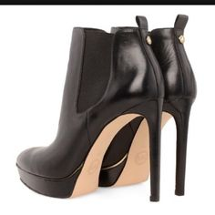 """Michael Kors🎉HP🎉Meadow Black Leather Ankle Boots ✨Great Condition✨ Stunning Genuine black leather booties with Pointed toe, Gold trim accents, 1"""" Platforms and 5"""" Stiletto heel. Beautiful condition. Minimum wear on bottom and inside. Elastic panels on top sides make them so comfortable and easy to put on! 💌Thank You for your Interest!!😘 ❌NO Trades❌ 💲Price FIRM, Use the Bundle Discount: 4️⃣Items=20%OFF!! ✨Can't find 4️⃣you like? Ask me to make you a custom BUNDLE. Michael Kors Shoes…"""