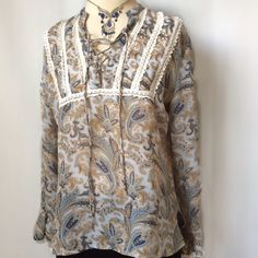 """Floral & Crochet Tunic Blouse Top XUC: slight hi/lo; tie front & crochet detail; cuffed ruffle sleeves w/crochet detail; approx 27"""" long & relaxed bust approx 38"""" Tops Tunics"""