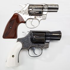 Pair of Third Issue Colt Detective Specials - The 1st is a mint condition nickel-plated Detective Special with checkered wood grips & floral style engraving. The second is an ivory-gripped Colt with floral engraving in the blued finish & accented with an outline in gold. These snub nose pistols of were often depicted as the favored hideout piece of lawmen and private investigators in the 30s-40s. These Third Issue Colts were manufactured later on, during the production range of 1973-86.