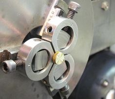 Machine small work unobstructed, A solution is to make a set of tool makers mini jaws, they clamp on to the regular jaws of the chuck so they expand and contract as normal.