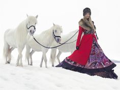 Russian inspiration. Russian beauty. Russian girls. Winter. Traditional Russian clothes. Fur hat. Horses