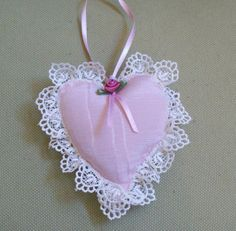 Heart shaped sachet with pink satin rose