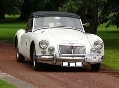 The MGA was a vehicle from MG that was produced between 1955 and This auto was the replacement for the MG TF 1500 Midget and was a sports car that had completely new styling compared to previous sports cars from MG Frankfurt, Vintage Cars, Antique Cars, Car Cost, Exterior Door Handles, Jaguar Xk120, Mg Cars, British Sports Cars, Rear Wheel Drive