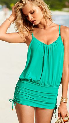 Convertible one piece: Adjustable side ties allow this swimsuit to be worn classic with ruching or as a mini dress