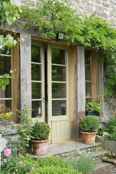 Beautiful French doors and stone steps, facade wisteria and boxwoods