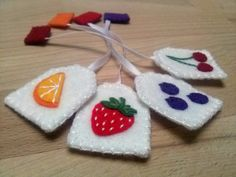 Play food - Tea party playset - 4 felt tea bags - standard size  Set includes 4 different tea bags Flavors :  - orange, mint, blueberry, cherry  Great for pretend tea party  Dimensions...