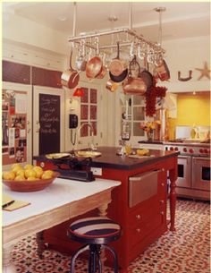 Peter Dunham - kitchen, like the red accents and chalk board/bulletin board refrigerator/freezer.
