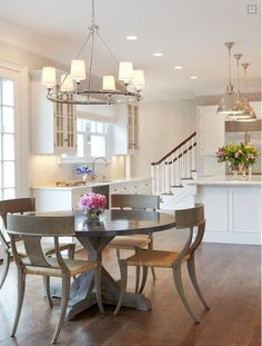 Kitchen by Chango and Co (NYC design firm). White kitchen with blue/gray furniture