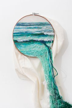 Fiber ocean art with waves embroidery by Ana Teresa Barboza