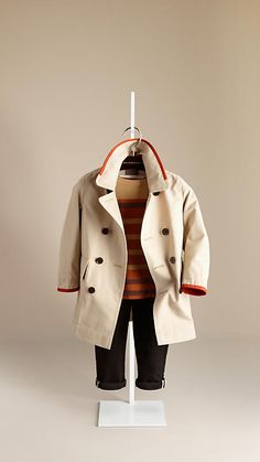Burberry - CONTRAST TRIM TRENCH COAT  Lightweight cotton and nylon trench coat with contrast trim  Notch lapels, flap pockets, centre vent   Horn buttons engraved with the Burberry logo  My boy would be smokin' cute in this.