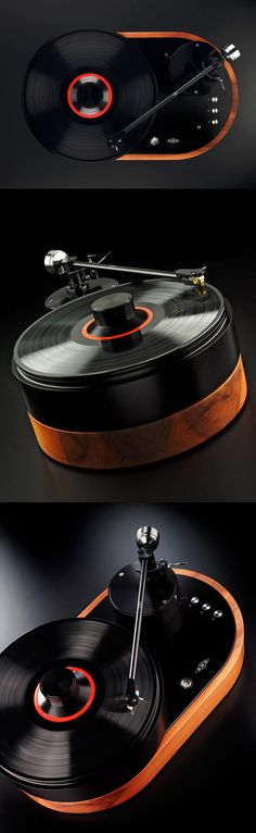 """V12 Turntable by AMG -- The German-based Analog Manufaktur Germany (AMG) designed the V12 to """"advance the art of vinyl playback"""". The curvaceous shape and contours of the the V12 reflect the vinyl medium and the optional wood casing adds another visual element to an already impressive product."""