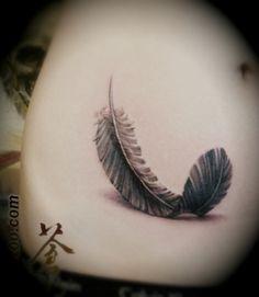 Gorgeous feather tattoo!