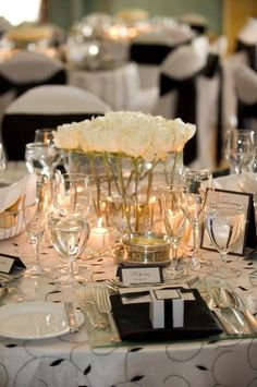 i like low center pieces so people don't have to talk to each other through the high floral arrangement.