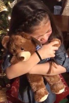 Mariana, who opened her bear first, was so overwhelmed she burst into tears and hugged the bear as if it were her late grandpa. | People Can't Stop Crying At These Girls Being Given Teddy Bears With Their Late Grandpa's Voice - BuzzFeed News