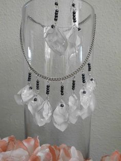 my handmade - jewelry of white and transparent plastic bottles