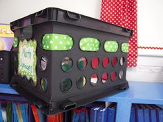 Classroom decorations: I love the ribbon threaded through this crate! Combine this with the cushioned seat crate pin and it's perfect music kit storage and seating!