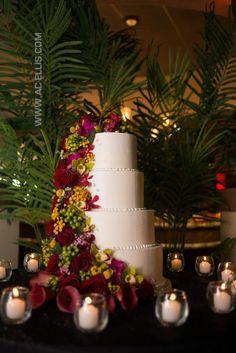 4 tiered round wedding cake with fresh flowers