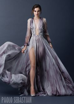 This designer evening gown featured in a 2015 collection during fashion week shows what is popular during this third era of modern fashion that we currently live in.