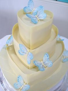Blue butterfly and white chocolate cake by Nicky Grant~ Butterflys and Chocolate. This site has simply stunning cakes.the butterflies look so delicate and are hand painted on edible rice paper. Beautiful Wedding Cakes, Gorgeous Cakes, Pretty Cakes, Cute Cakes, Amazing Cakes, Butterfly Wedding Cake, Butterfly Cakes, Blue Butterfly, Papillon Butterfly