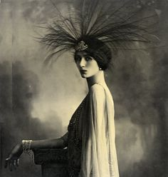 The Countess Spalletti looking resplendent in a luxurious headdress of egret feathers.