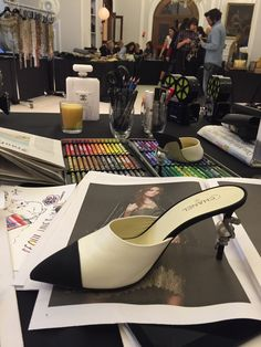 """""""I have made mules, which Chanel never did,"""" says Lagerfeld about his new Coco shoe - a classic design, apart from the snake winding it's way around the heel below the big, fat pearl   (Foto: SuzyMenkesVogue)"""
