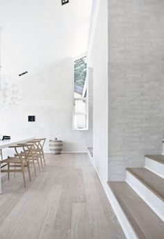 Grey floors and white brick walls. Design: Floors (Fredensborg House BY Norm Architects).