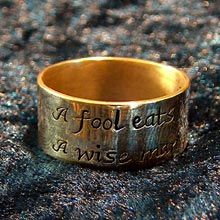 """this ring says, """"A fool eats his last potato. A wise man plants it"""" which is an Irish saying from the time of the potato famine -- a symbol of patience and overcoming fears"""