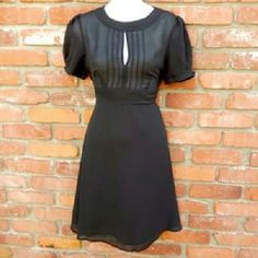 Vintage Style! Black Dress Simply adorable. This little black dress screams vintage style.  Black with 8 buttons down the back. Attached self tie belt.  100% polyester,  lined from the waist down. No flaws!  Length: 35 inches.  Waist:  15 inches.  Underarm to underarm: Forever 21 Dresses