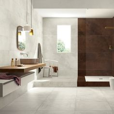 Refin Ceramics Mansion wood-look tile flooring.  Available in Magnolia Natural Chevron 300x1200