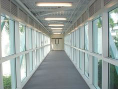 Welded aluminum and glass enclosed pedestrian bridge fabricated and installed by Mullet's Aluminum