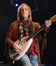 Tom Petty Playing Guitar in Concert