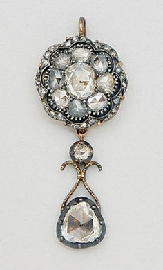 Antique Diamond, Silver and Gold Pendant   Set with foiled rose-cut diamonds, height 1 1/2 ins, width 5/8 in. Georgian or Georgian style.