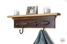 These beautiful cast iron fish hooks would look stunning hanging on the wall in your entryway, bedroom, bathroom or mudroom. This coat rack is filled with beautiful details such as the wood trim and the rustic fish hooks, making it a very unique piece. Use this rustic shelf with hooks to store and organize would make an excellent coat hook for your hats, coats, keys, or fishing gear.