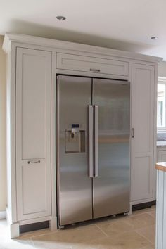 Handmade shaker style kitchen by Benchwood Kitchens. Two side cabinets, one being a pull out unit, the other with a door and an overhead cabinet make this ideal for a fridge unit www.benchwoodkitchens.co.uk