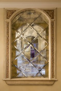 A pattern of beveled, antiqued mirrors lends jewel-like sparkle to a wall niche.
