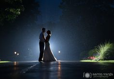 Rainy wedding, backlit rain photo, Shannopin Country Club. Aaron Varga Photography