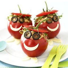 Very clever idea.  Mr. tomato head. Hollow the tomato and fill it with salad, tuna, couscous..anything you like and then use olive slices for eyes and cheese for a mouth