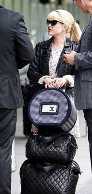 Kelly Osbourne with her Chanel Luggage...it's beautiful, classy - that's the way to travel