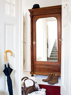 mirrored armoire in the hall Antique Wardrobe, Antique Armoire, Mirrored Wardrobe, Entry Closet, Entry Hallway, Closet Doors, Entryway, Wardrobe Furniture, Wardrobe Cabinets