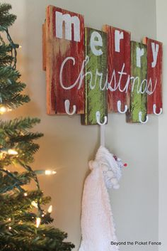 Scrap Wood Stocking Hanger. You could also make it larger and do your family name to use as a coat hanger!