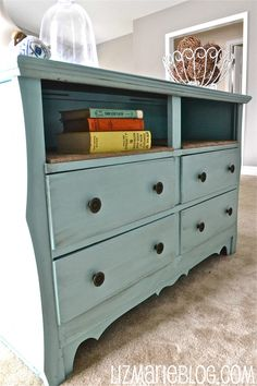 Turn that dresser that's missing a drawer or two into a media center, or a console behind the couch by giving it a rustic paint job and a couple of shelves.......D.