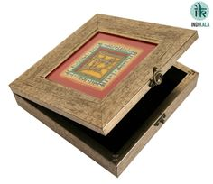 This antique finish dhokra warli box is ideal to store anything, ranging from jewellery to knick knacks. Uniquely handicrafted with tribal figurines, the warli paintings are artistically done with vibrant colours, which make it an aesthetic piece of art to treasure. Box has a latch on the front and velvet inside.