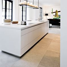White flush kitchen and Paris Ceramics limestone | nice tiles and cabinetry - love the floor!