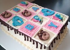 Building Blocks Baby Shower Cake A pleasure for the chocolate-loving Mom to Be with 2 layers of Rich and Moist devil's food cake, filled with whipped chocolate ganache and frosted with clouds of luscious swiss meringue buttercream. Baby Shower Souvenirs, Baby Shower Prizes, Baby Shower Party Favors, Baby Shower Cupcakes, Shower Cakes, Pop Baby Showers, Elephant Baby Showers, Swiss Meringue, Meringue Cake