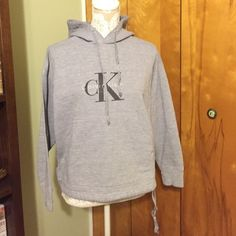 Calvin Klein hoodie Gently used condition. Ties around the bottom Calvin Klein Sweaters