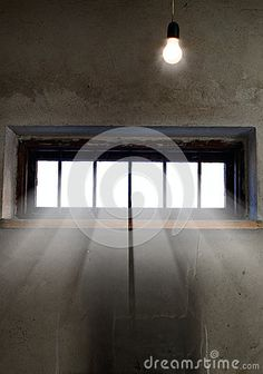 Light is coming through the barred window by Esviesa, via Dreamstime